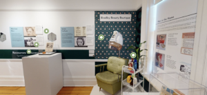 """A snapshot of """"The Lengths We Go: Reflections on Hair"""" virtual tour. This photo shows parts of the exhibit and features wall posters, photos, and the museum interior."""